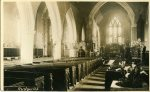 Interior of church at Easter; has original 'tortoise' stove as only heating, replaced before 1st World War