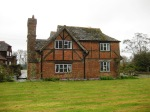Cousins Farm in The Haven , relatively unspoilt group of old buildings, including barns and converted granary, is a late 2-bay hall house 1500, with chimney 1650 and wing on right C18th. Long association with Ireland family