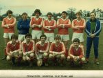 1981 Cranleigh Hospital Cup team, first colour photo. Post-war strip no longer striped. Village Hall in background